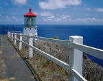 Oahu, HI: Makapuu Head Lighthouse (1909), above the blue water of Waimanalo Bay on Oahu's Windward Coast