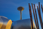Seattle, WA: Experience Music Project building and the Space Needle with corner of Grass Blades sculpture by John Flemming