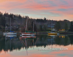 Vashon Island, Washington: Winter sunset over Quartermaster Harbor and boats with Christmas lights