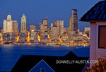Seattle, Washington: Dusk on Elliott Bay with the Seattle city skyline glowing in reflected light, from a West Seattle neighborhood