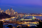 Seattle, Washington: Night view of the city skyline, Elliott Bay and hillside homes of the Queen Anne neighborhood