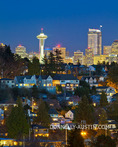 Seattle, Washington: Night view of the city skyline and hillside homes of the Magnolia neighborhood