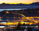 Seattle, Washington: Evening view of the Olympic mountain skyline with hillside homes of the Magnolia neighborhood