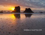Bandon State Park, Oregon: Sunset reflections at low tide with silhouetted seastacks at Bandon Beach
