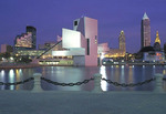 Night view of Cleveland, Ohio skyline with the Rock N Roll Hall of Fame and Musuem.