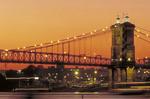 The John A. Roebling Suspension Bridge at dusk over the Ohio River in Cincinnati, Ohio