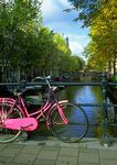 Pink bicycle and canal