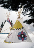 American Indian teepees in the snow.