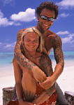 Man and woman with tattoos on the beach
