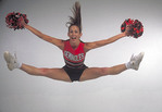 Teenage cheerleader doing a jump