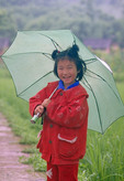Chinese girl in the rain