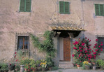 Old stone home with flowers in Tuscany