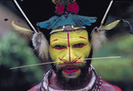 Colorful painted face of Huli Wigmen