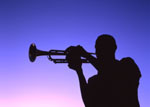 Young black man playing a trumpet