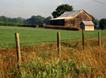 Fence and rustic barn with hay bails