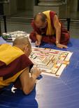 Buddist monks painting sand mandala