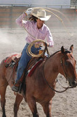 Cowgirl roping at a rodeo