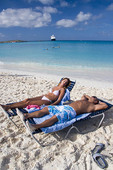 Homeynoom couple at Half Moon Cay beach, Bahamas