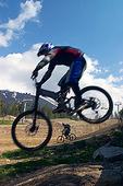 Mountain bikers speeding down Whistler mountain