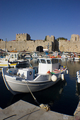 Boat harbour in Rhodes, Greece, showing Medieval castle walls