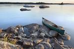Canoe at sunset from rock island off the shore of Round Bear Island, Kabetogama Lake, Voyageurs National Park