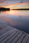 Sunset from wooden dock, Whispering Pines, Lake Kabetogama, Voyageurs National Park, Minnesota