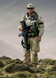 American soldier looking over mountain