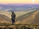 Afghanistan Man walking into Sunset in Hindu Kush mountains