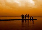 Sunset with men praying