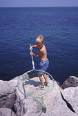 Young boy with fishing net