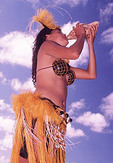 Native woman blowing in conch shell on Aitutaki, Cook Islands
