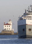 Ship on Lake Erie passing Fairport Harbor Lighthouse