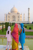 Hindu women with colorful veils in the quiet peaceful Taj Mahal one of the wonders of the world in Agra India