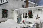 Ice and snow covered home