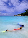 Snorklers in the water at  La Digue in the Seychelle Islands of Africa