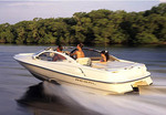 Couples running motor boat with wake