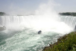 Maid of the Mist boat approaching Horseshoe Falls Niagara Falls