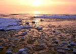 Sunrise over ice patterns on Lake Michigan