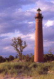Little Sable Point lighthouse against a stormy, evening sky