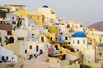 and The beautiful white buildings on the mountain cliffs of the small isolated roamntic city of Oia