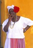 Colorful Cuban woman smoking a cigar