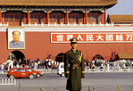 Policeman in Beijing, China next to a portrait of Mao Tse Tung