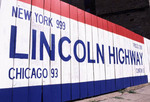 Fence painted with Lincoln Highway sign