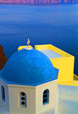 Oia Santorini Greece and a beautiful church with blue roof