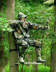 Bow and arrow hunter aiming.