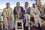 Egyptian men smoking sisha pipes, water pipes commonly smoked in arabic and north african countries.