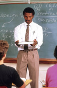 A black african-american male teacher teaching math in high school with students listening.