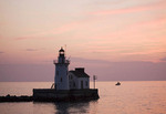 West Pierhead Lighthouse at sunset in Cleveland, Ohio.