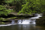 A canyon waterfall at Giant's Bathtub in the upper dells at Matthiessen State Park.