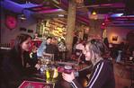 Two Estonian girls enjoying drinks at a bar in Tallinn.